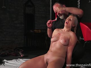 A master gives his slave a hot wax treatment and that comprehensive is thick as fuck
