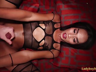 Thai ladyboy Game in her kinky fishnet outfit enters the bedroom
