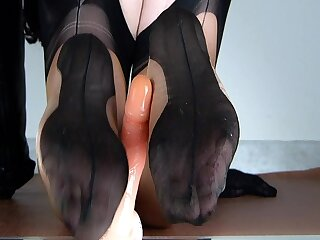 Lady Lulu volte-face footjob in bicolor fully fashioned