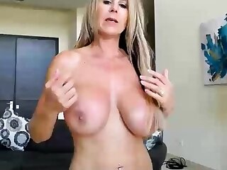 Big boobs milf masturbates adjacent to her dildo
